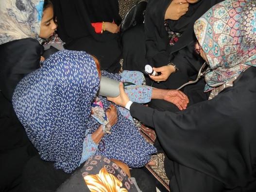 اردوی جهادی کانون بسیج هنرمندان جهرم در محله سنگ جوغنی